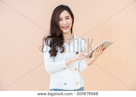 Portrait Of Beautiful Young Smiling Happy Woman Browsing Internet On Digital Tablet Computer Isolate