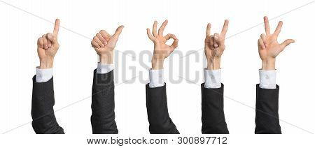 Businessman Hand In Suit Showing Various Gestures. Okay, Victory, Rock, Finger Pointing And Thumb Up