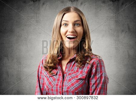 Happy Charming Girl Smiling Wide. Emotional Young Woman Has Surprised Facial Expression. Portrait Of