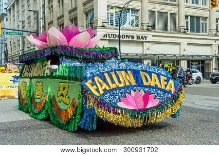 May 12, 2019 - Vancouver, Canada: Falun Dafa Float In Parade Through Streets Of Downtown On Mothers