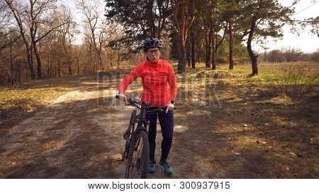 The Topic Health Problems With Athletes. Caucasian Woman Cyclist On Mountain Bike Finish Workout In