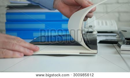 Office Desk Image With Businessman Hands Opening New Agenda And Browsing Pages