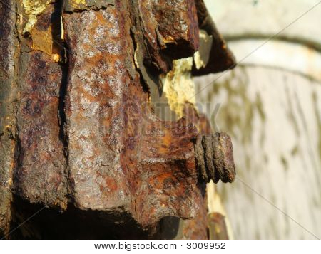 Rusty Screw And Metal Piece