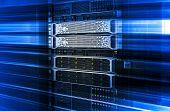 Server rack with working mainframe disk storage under motion blue effect poster
