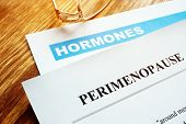 Perimenopause and menopause concept. Documents about hormones. poster