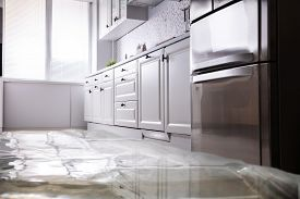 Close-up Of Flooded Floor In Kitchen From Water Leak