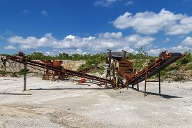 Old Rusty Stone Crushing Machines In Abandoned Quarry