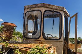 Overgrown Old Yellow Cracked And Abandoned Excavator