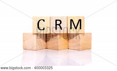 Crm, Cube Wooden Block With Alphabet Combine The Word Abbreviation Crm On White Background.