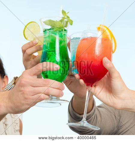 Group Of Happy Friends Celebrating Toasting With Glasses Of Cocktails