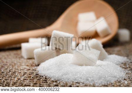 White Sugar. Pieces Of Refined Sugar On The Fabric. Sugar