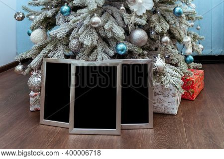 Silver Photo Frames Or Certificates Under The Christmas Tree With Gifts