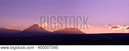 Sunrise Behind The Andes Mountain Range, With The Altiplano Line (high Andean Plateau) In Silhouette
