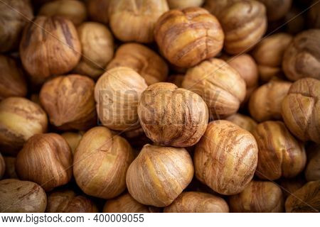 A Lot Of Hazels Nuts Close-up. Natural Background For Healthy Eating Concept.
