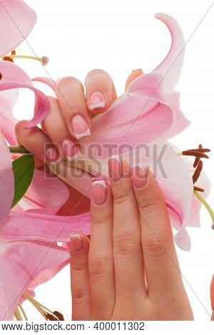 French Manicure. Female Young Hands Groomed Isolated On A White Background With Flowers.