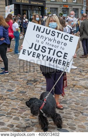 Richmond, North Yorkshire, Uk - June 14, 2020: A Woman Wearing A Face Mask Holds A Banner Quoting Ma