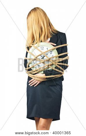 Businesswoman with clock tied up on white