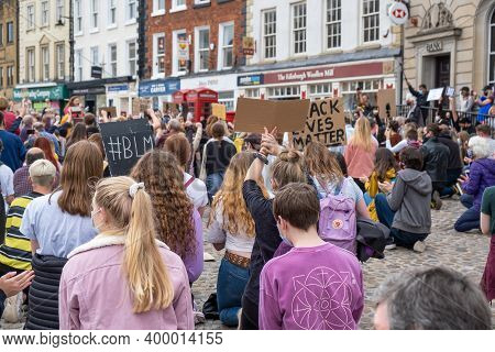Richmond, North Yorkshire, Uk - June 14, 2020: A Group Of Protesters Kneeling At A Black Lives Matte