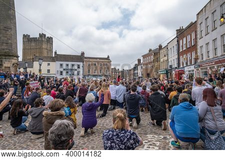 Richmond, North Yorkshire, Uk - June 14, 2020: A Gathering Of Protesters Kneel At A Black Lives Matt