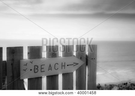 Beach Direction Sign - Wooden, Painted Pink, With Sea And Sky.
