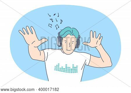 Listening To Music, Recreation Concept. Smiling Man In Headphones Listening To Favourite Music And D