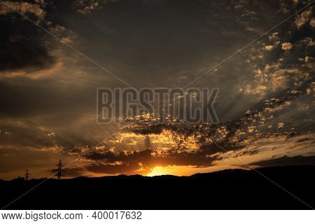 Sunset On A Cloudy Day With Sun Rays With Copy Space