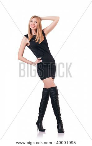 Attrative woman wearing topboots on white