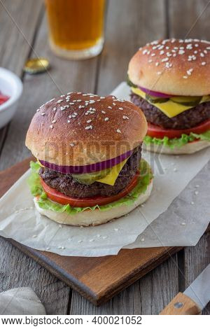 Burgers With Meat, Tomato, Cucumber, Cheese And Onion. American Cuisine. Fast Food.