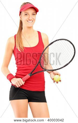 A young female tennis player holding a racket and ball isolated against white background
