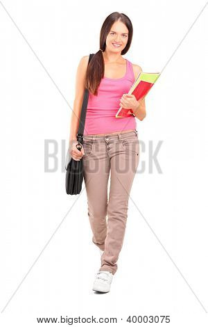 Full length portrait of a female student with shoulder bag and books walking isolated on white background