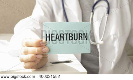 Heartburn Written On A Card In Doctors Hands