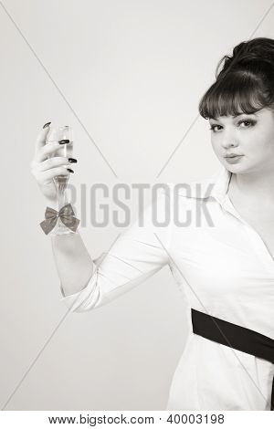 attractive woman with decorated wineglass. studio shot