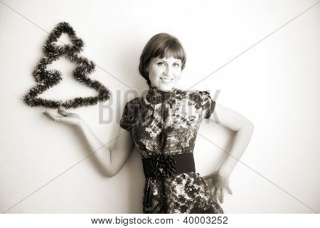 portrait of attractive woman with fir-tree. indoor shot
