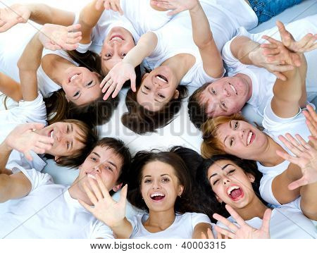 young lying people smile over white background