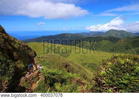 Guadeloupe, France - December 1, 2019: People Hike The Summit Trail To La Soufriere Volcano In Carib