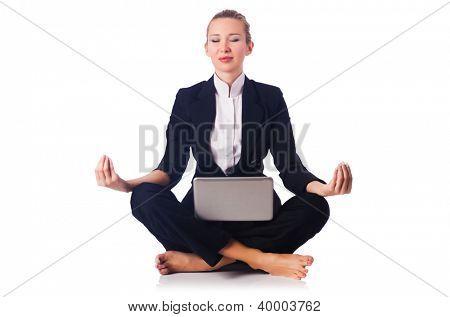 Businesswoman meditating isolated on white