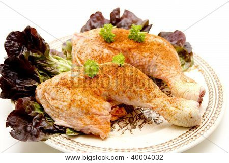 Raw Chicken Drumstick on Plate
