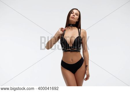 Side View Of Attractive Erotic Hispanic Young Woman In Lingerie Crossing Hands Looking At Camera