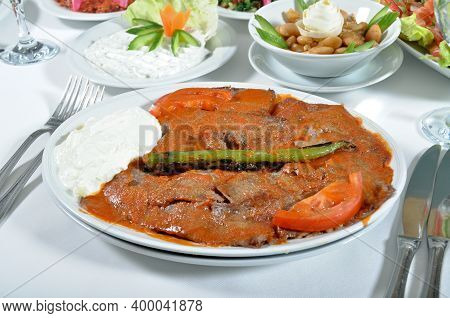 A Magnificent Dining Table And Traditional Iskender Kebab In A Luxury Restaurant, Turkish Traditiona