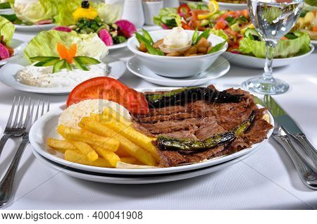 A Magnificent Dining Table And Traditional Doner Kebab In A Luxury Restaurant, Turkish Traditional D