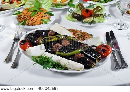 A Magnificent Dining Table And Patlican Kebab In A Luxury Restaurant, Turkish Patlican Kebab
