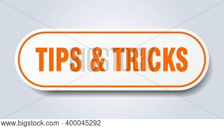 Tips And Tricks Sign. Tips And Tricks Rounded Orange Sticker. Tips And Tricks