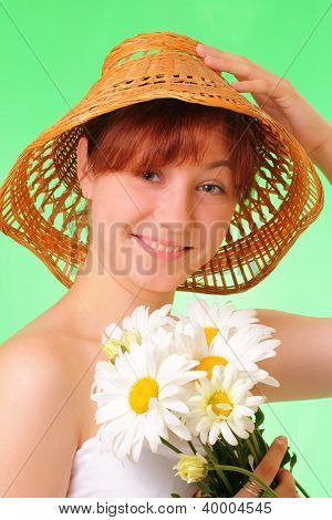 Happy Young Girl With Chamomile Flowers