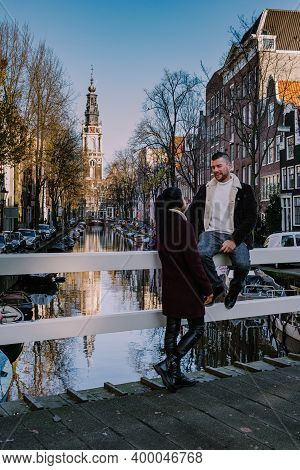 Amsterdam Canal With View At The Zuiderkerk Amsterdam Church Canalside Netherlands. Europe, Couple A