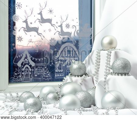 Silver Christmas Decorations And Beads With Pedestals On Windowsill At Night, Festive Window At New