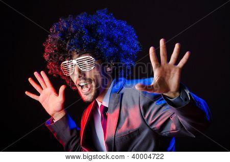 Singer with afro cut in dark studio