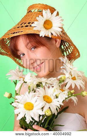 Pretty Young Girl In The Hat With Chamomile Flowers