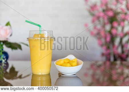 Mango Smoothie In A Glass. Mango Shake. Tropical Fruit Concept. Refreshing And Healthy Mango Smoothi