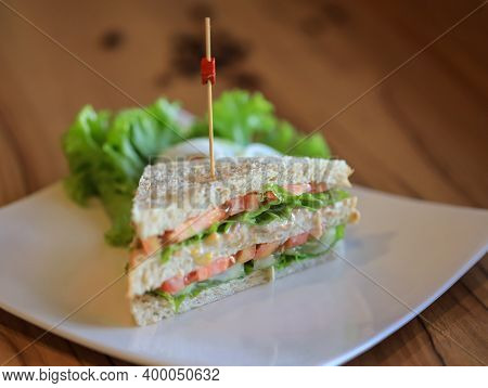 Freshly Made Club Sandwiches. Club Sandwich With Sausage On A White Plate. Club Sandwich With Cheese