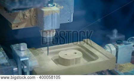 Cnc Engraving Milling Machine Cutting Wooden Workpiece At Futuristic Technology Exhibition. Woodwork